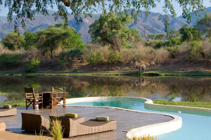 Это проект танзанийского архитектора Нила Рочера. Отдых в этом домике на  реке запомнится вам на всю жизнь. Он расположен в окружении диких джунглей  Замбии и ... de273d68ca3db