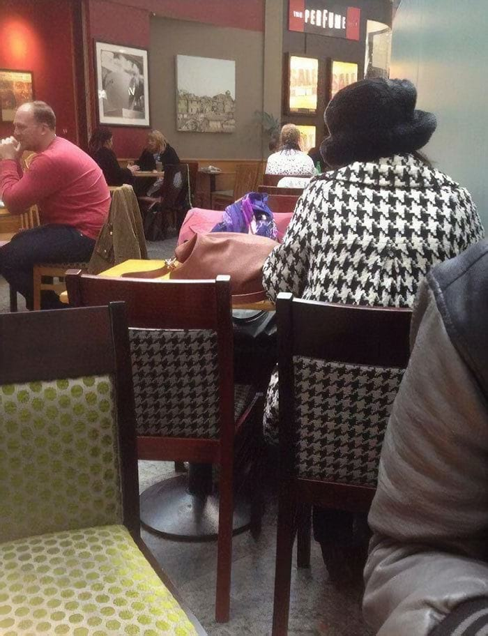 Her Coat Had The Same Pattern As The Chair